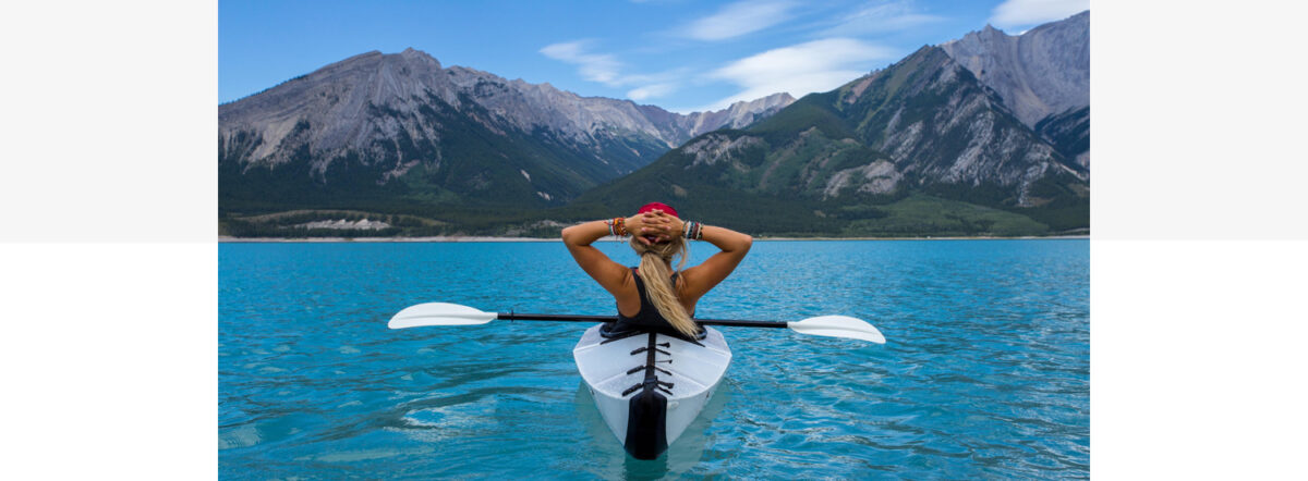 Canoeist with mountains in the background. Photo: Kalen Emsley from Unsplash.